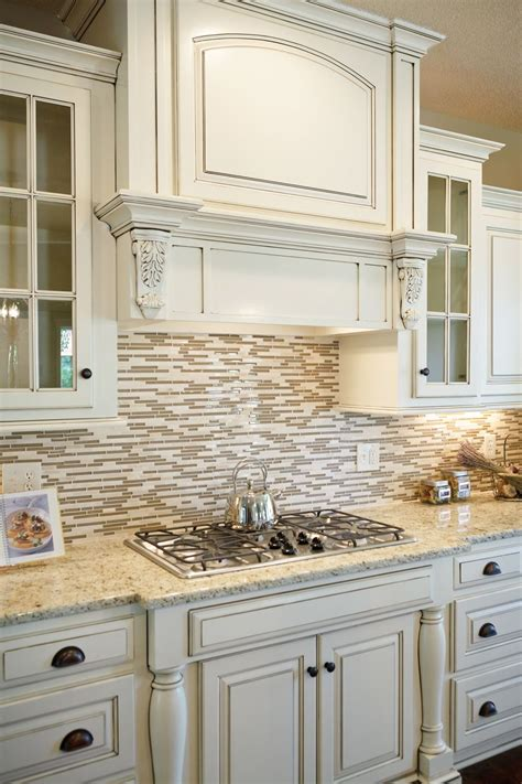 white counters  granite  tile backsplash kitchen