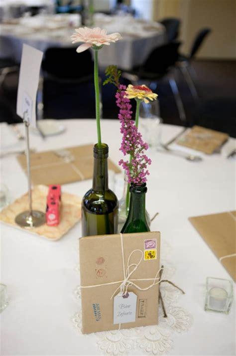 wine bottle grouped  centerpieces  wedding blog
