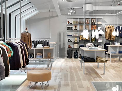 Men's Clothing Boutique In Living Room Mirrors Grey Couch Ideas Furniture Rooms To Go Sets For Small Paint Colors With Black Leather Sofa Dark Interiors India