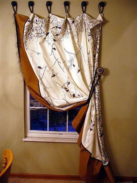 using wooden knobs to hang curtains with curtains