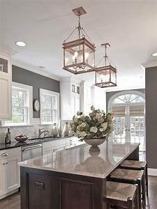 Grey kitchen island and walls white marble paint above