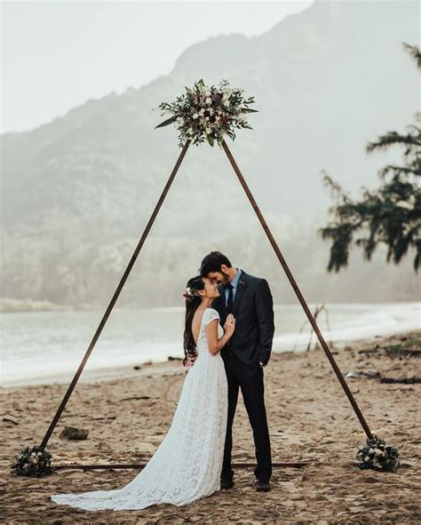 hot wedding trend  triangle wedding arches weddingomania