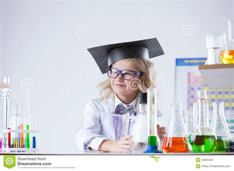 Petite Blonde Schoolgirl Posing In Laboratory Stock Photo Image Of Graduate Glass