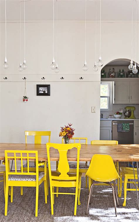 mismatched chairs painted yellow for the dining room