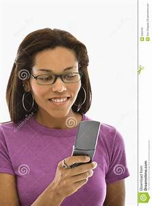 Young Woman Using Laptop And Talking On Cellphone Stock