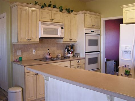 top of kitchen cabinet ideas best distressed white kitchen cabinets ideas all home