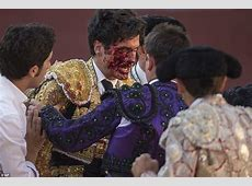 Matador Lorenzo Sanchez is pinned to the floor and gored