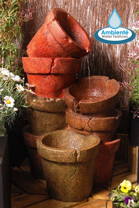 stacked plant pot cascading water feature  lights