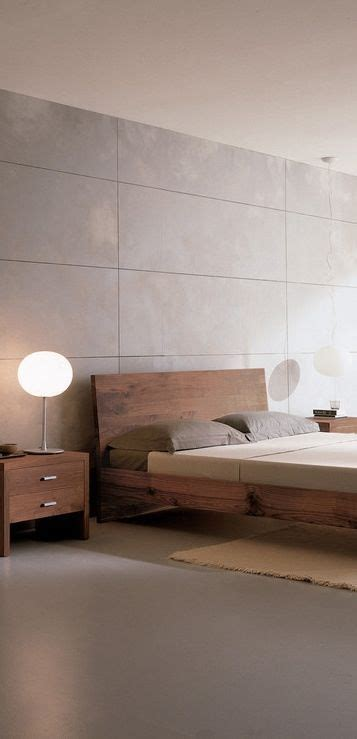 large format tiles as a feature wall in this bedroom give