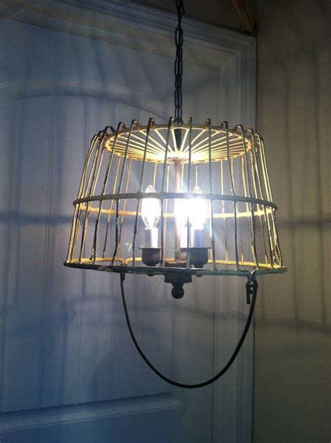 chandelier made from repurposed light fixtures and a wire