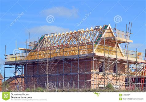 New Build House With Roof Rafters And Scaffolding Stock
