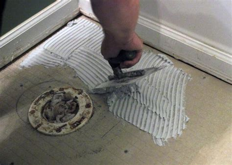 Replace Bathroom Tiles by How To Install Bathroom Floor Tile How Tos Diy