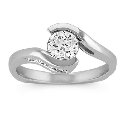 swirl  bezel  channel set diamond engagement ring