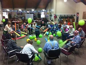 "Pool ""noodles"" and balloons Staying active and having fun"