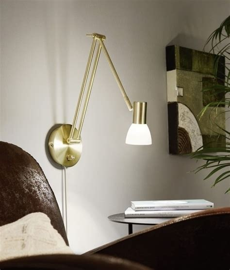 adjustable anglepoise inspired wall light with glass shade