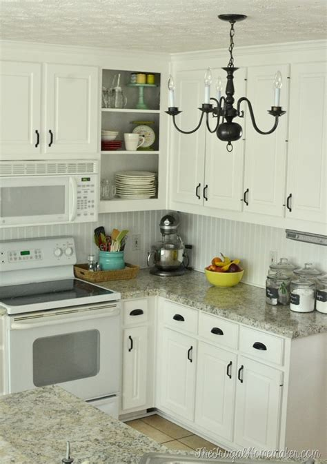 painting kitchen cabinet hardware how to re paint your yucky white cabinets 4022