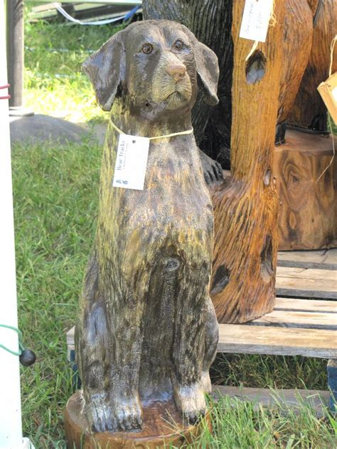 bear tracks chainsaw carving dog sculptures