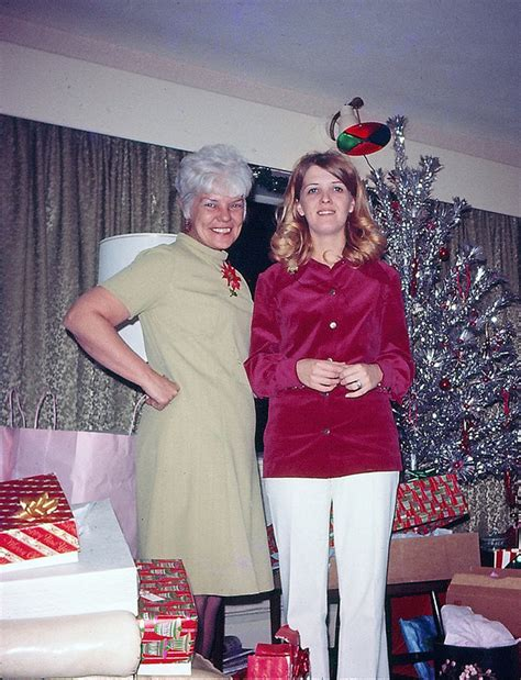 mid century women enjoying aluminum christmas trees flashbak