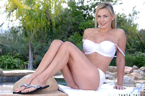 Busty Blonde Mature Tanya Tate Shows Off Her Tempting Cleavage As She Slowly Strips Beside The