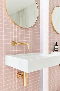 Colorful small bathroom with orange walls also white for Interior design pink bathrooms