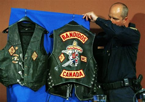 An Opp Officer Places Biker Vests Seized In Raids On