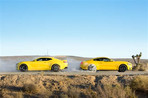 Mustang Vs Camaro A Timeline Of The Muscle Car Rivalry