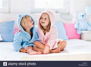 Happy laughing kids boy and girl in soft bathrobe after for Girls in bathroom with boys