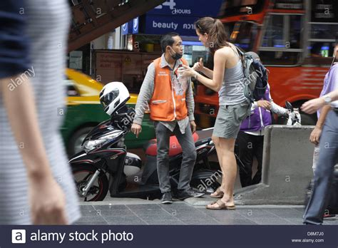 Foreign Tourist Talking With Thai Motorcycle Taxi On Silom Road In Stock Photo, Royalty Free