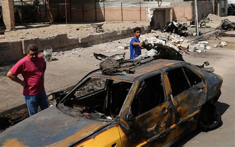 car bomb is claims iraq car bomb blast that killed over 100 police sbs news