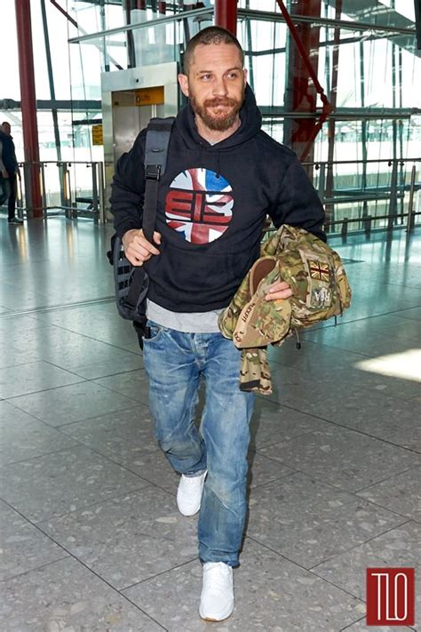 tom hardy catches flight heathrow airport tom lorenzo