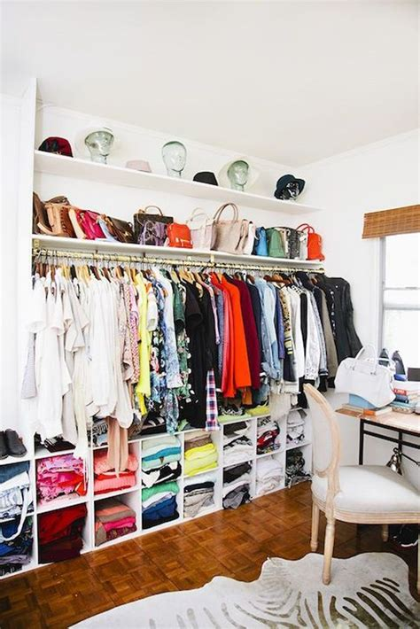 Open Closet Shelves by An Open Wardrobe I Especially Like The Glass Heads To