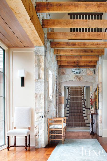 contemporary neutral entry  stone walls luxe