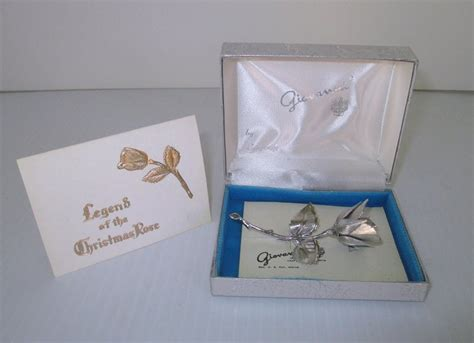 giovanni legend   christmas rose silver lapel brooch