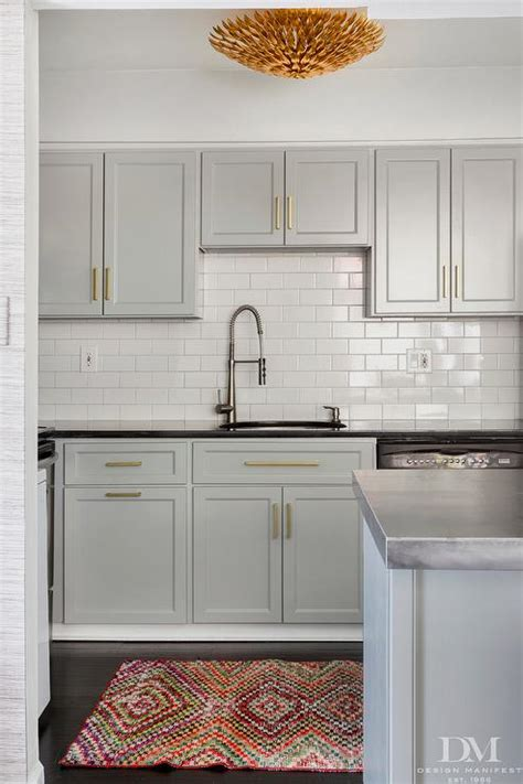 light grey kitchen cabinets with gold hardware gold and gray kitchen with steel countertops