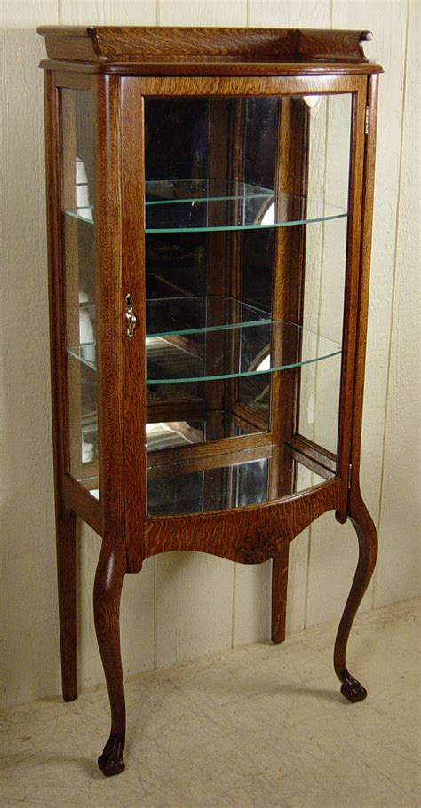 oak curio cabinets with curved glass