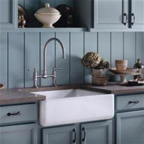 bronze kitchen sinks kitchen with white cabinets backsplash and 1819