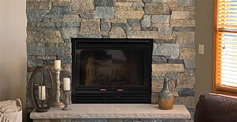 interior stone veneer modern rustic living room fireplace