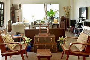 A filipino inspired duplex with antiques and wooden pieces for House interior design manila