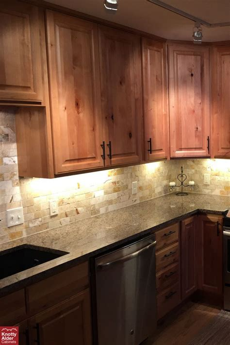 knotty alder cabinets natural stain kitchen cabinets