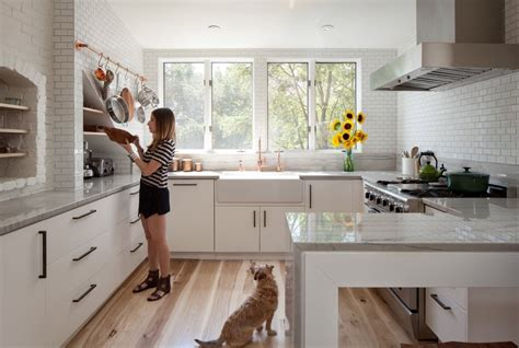 white kitchen wood floors wood flooring warms up a white kitchen 1816