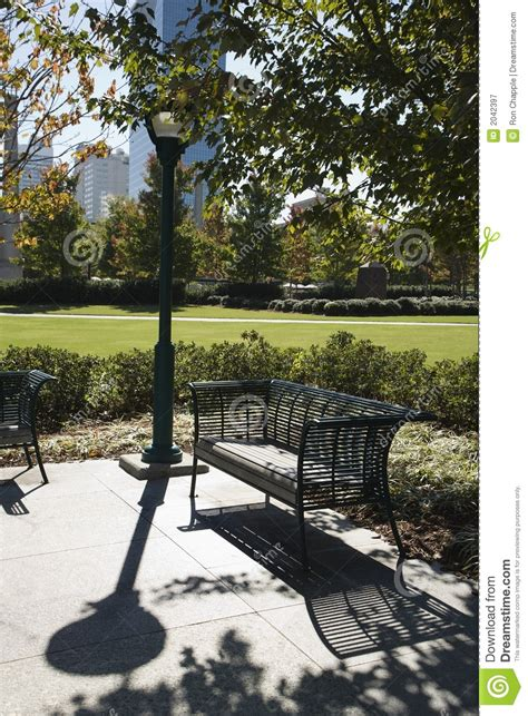 park bench atlanta empty bench in park in atlanta royalty free