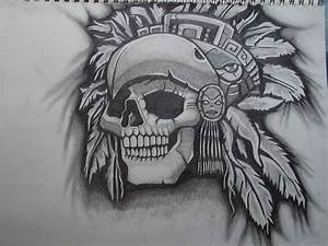 Aztec Skull With Feathers Tattoo