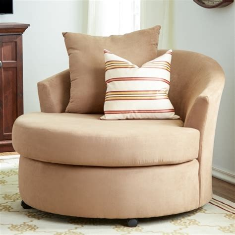 declain oversized swivel accent chair in sand