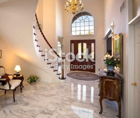 grand foyer staircase chandelier marble floor showcase