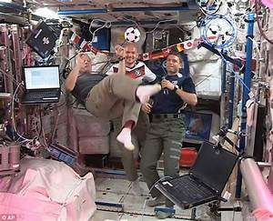 World Cup fever hits space as six astronauts show off ...