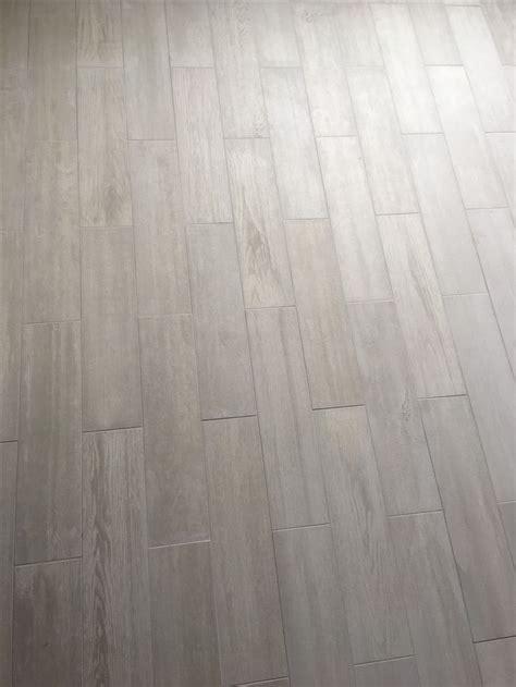 white wood look porcelain tile lowe s eldon white wood look porcelain tile with silver grout from menards home pinterest