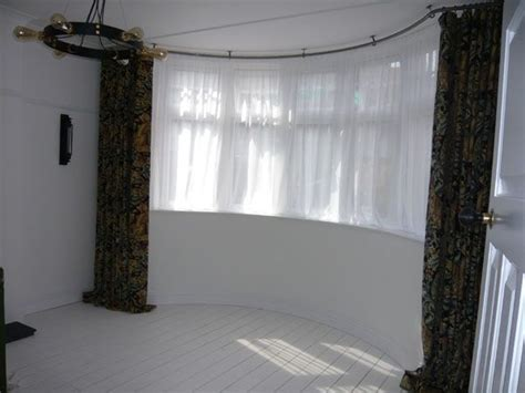 bay window curtain windows rail curtains pole ceiling rails poles voile fix styles bow room living track homedecorideas tracks dressing