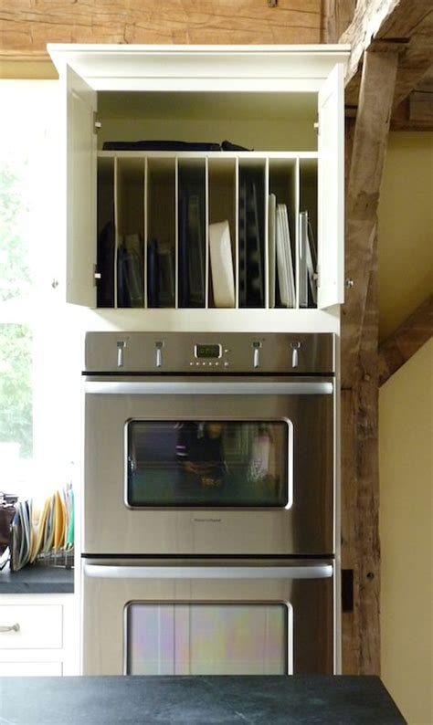 what to do with the space above your kitchen cabinets great vertical storage for cookie sheets cutting boards 2287