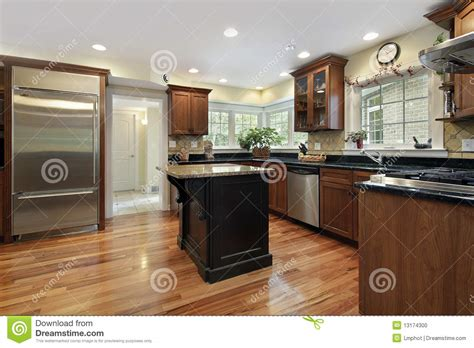 kitchen with black and granite island stock photo image