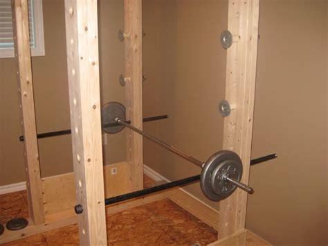 homemade power rack    wood  pipe